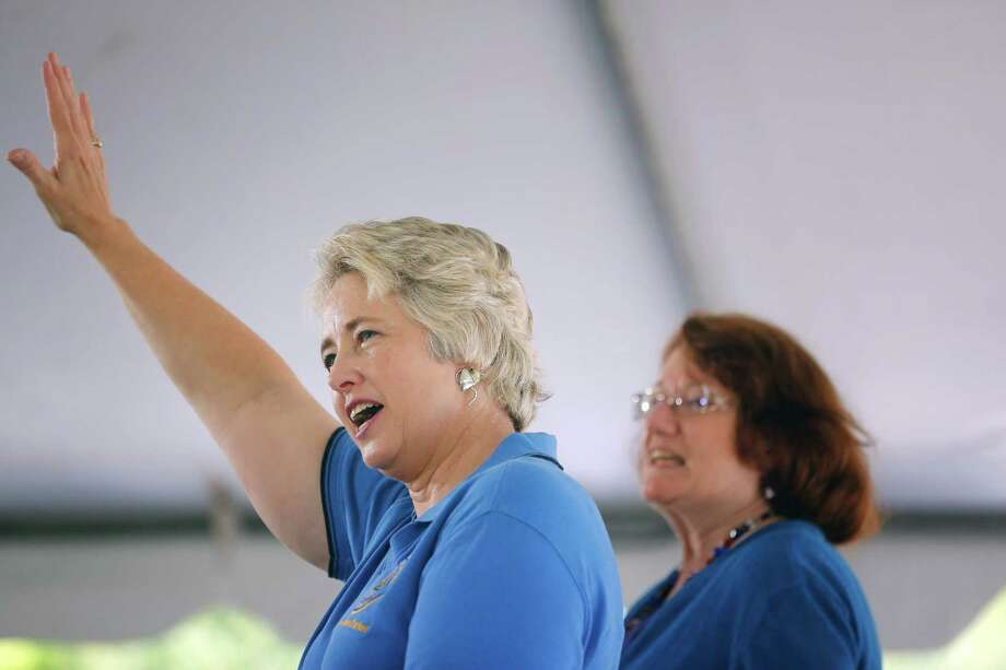 Houston mayor, Annise Parker, speaks to a gathered crowd of supporters, while her domestic partner, Kathy Hubbard, right, watches, Saturday, May 11, 2013 during a rally to officially announce her run for a third mayoral term, at Stude park in Houston, Texas. Photo: Todd Spoth, For The Chronicle / © TODD SPOTH, 2013