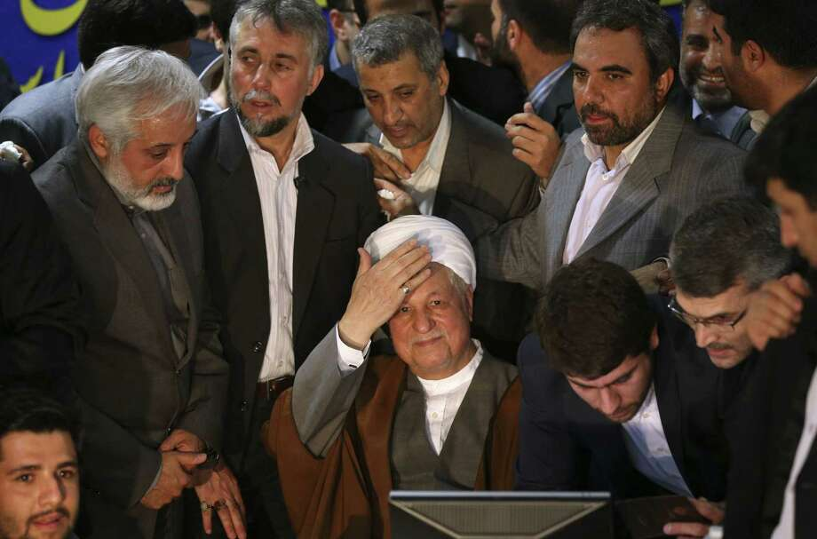 Former President Akbar Hashemi Rafsanjani registers his candidacy for the upcoming presidential election. Photo: Ebrahim Noroozi / Associated Press