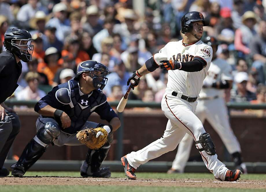 San Francisco Giants' Gregor Blanco, right, drives in three runs with a bases-loaded double against the Atlanta Braves during the fifth inning of a baseball game on Saturday, May 11, 2013, in San Francisco. (AP Photo/Marcio Jose Sanchez) Photo: Marcio Jose Sanchez, Associated Press