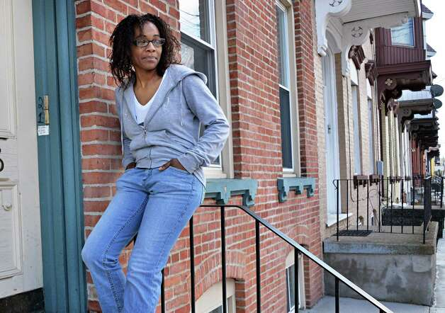 Ronita McColley on the front stoop of her home in Troy, NY Thursday April 25, 2013.  The apartment was torn apart by a drug task force in 2008 after they raided the wrong house.  (John Carl D'Annibale / Times Union) Photo: John Carl D'Annibale / 10022146A