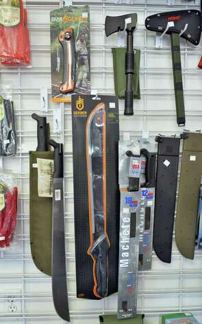 Machetes and hatchets on display at Y Die Emergency Preparedness shop in Gansevoort, NY TUESDAY APRIL 30, 2013.  (John Carl D'Annibale / Times Union) Photo: John Carl D'Annibale / 10022208A