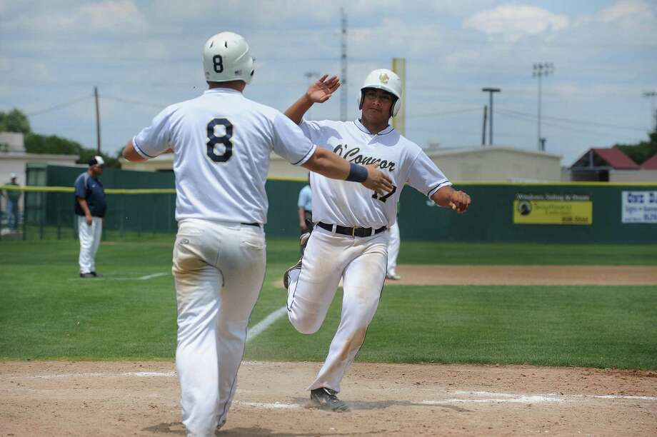 O'Connor's Jose Rodriguez (right) is greeted by teammate Billy Craft after scoring in the Class 5A area round Saturday. Photo: Billy Calzada, San Antonio Express-News / © 2013 San Antonio Express-News