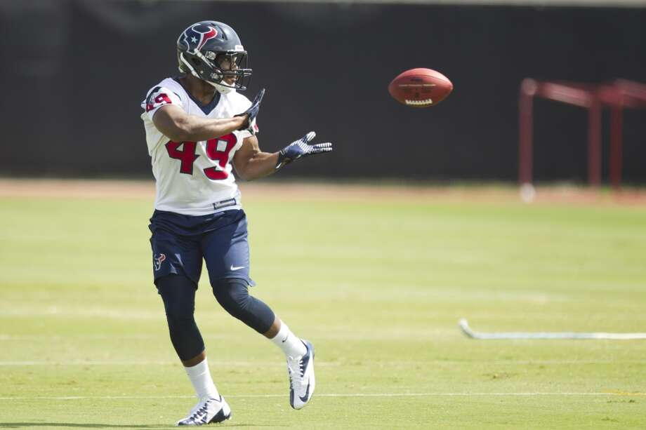 Texans fullback Barrett Matthews makes a catch during practice.