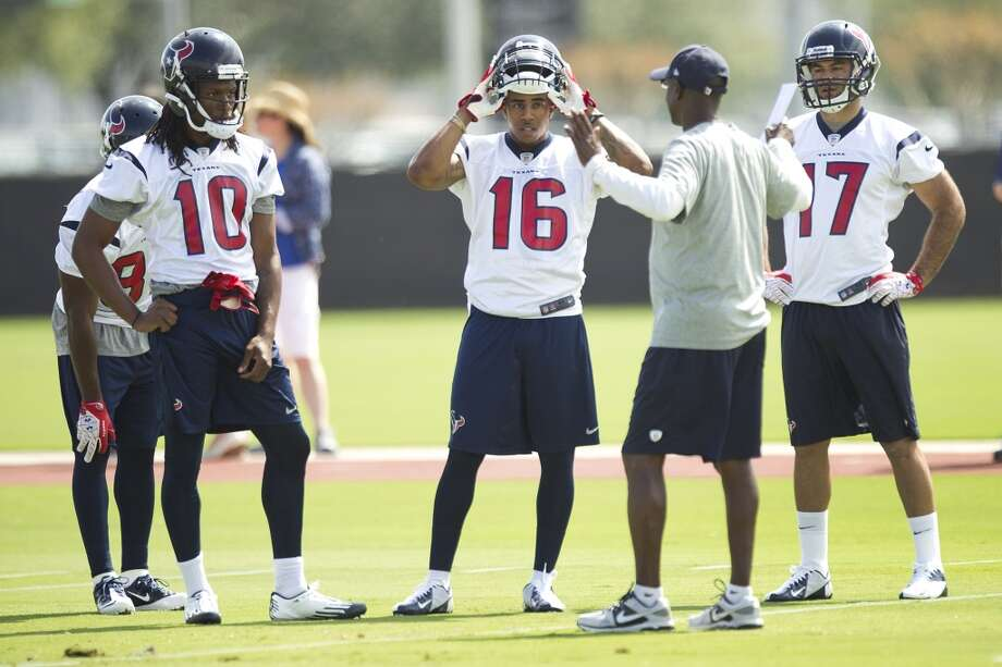 Texans wide receivers DeAndre Hopkins, Alan Bonner and Alec Lemon listen to receivers coach Larry Kirksey between drills.