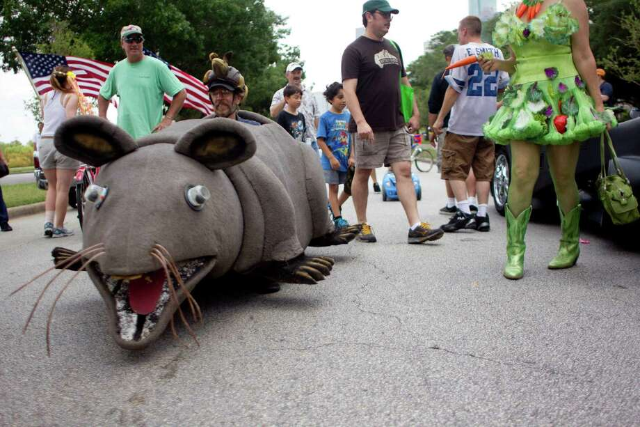 Robert Blue's art vehicle titled Fat Rat makes its way down Allen Parkway before the 26th annual Houston Art Car Parade May 11, 2013, in Houston. Photo: Johnny Hanson, Houston Chronicle / © 2013  Houston Chronicle