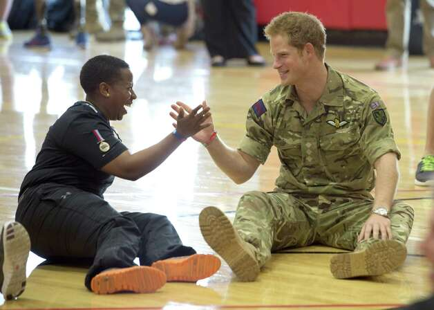 Prince Harry congratulates LCPL Maurillia Simpson as he competes in the Warrior Games during the third day of his visit to the United States on May 11, 2013 in Colorado Springs, Colorado. HRH will be undertaking engagements on behalf of charities with which the Prince is closely associated on behalf also of HM Government, with a central theme of supporting injured service personnel from the UK and US forces. Photo: Pool, Getty Images / 2013 Getty Images