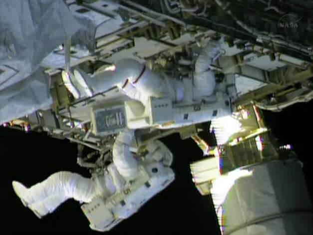 In this still image taken from NASA TV, International Space Station (ISS) astronauts Chris Cassidy (top) and Tom Marshburn finish work on repairs to the ISS on May 11, 2013. The astronauts repaired an ammonia leak which was discovered May 9. NASA emphasised that the lives of the multinational crew were not in danger but both Russian and US space experts were scrambling to swiftly fix the problem. NASA said the leak of ammonia, which is used to cool the station's power system, was coming from the same general area as in a previous episode in November 2012. Photo: -, AFP/Getty Images / AFP