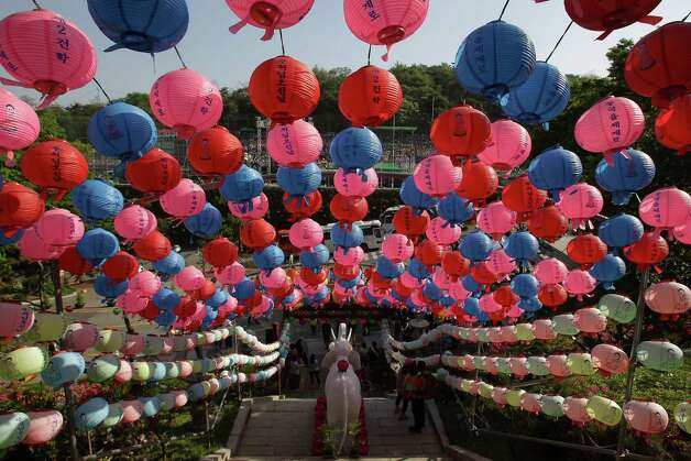 South Korean Buddhists walk under colourful lanterns as they celebrate the forthcoming birthday of Buddha at Dongguk University on May 11, 2013 in Seoul, South Korea. Buddha was born approximately 2,557 years ago, and although the exact date is unknown, Buddha's official birthday is celebrated on the full moon in May in South Korea, which is on May 17 this year. Photo: Chung Sung-Jun, Getty Images / 2013 Getty Images