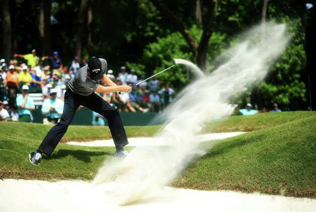 Chris Kirk of the USA plays his second shot from a bunker on the eighth hole during round three of THE PLAYERS Championship at THE PLAYERS Stadium course at TPC Sawgrass on May 11, 2013 in Ponte Vedra Beach, Florida. Photo: Richard Heathcote, Getty Images / 2013 Getty Images