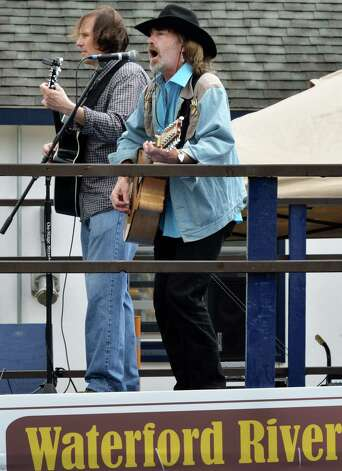 Justin Donohoe, left, and Herb Carter, Jr. perform at the 28th Annual Waterford/RiverSpark Canal Festival at the Waterford, NY Harbor Visitor Center Saturday May 11, 2013.  (John Carl D'Annibale / Times Union) Photo: John Carl D'Annibale / 00022346A