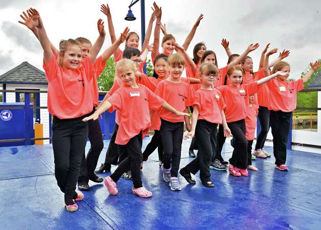 Students of the Spendwood School of Dance of Cohoes finish their performance at the 28th Annual Waterford/RiverSpark Canal Festival at the Waterford, NY Harbor Visitor Center Saturday May 11, 2013.  (John Carl D'Annibale / Times Union) Photo: John Carl D'Annibale / 00022346A