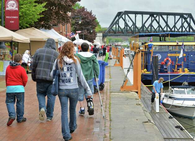 A little rain didn't keep the crowds from enjoying  the 28th Annual Waterford/RiverSpark Canal Festival at the Waterford, NY Harbor Visitor Center Saturday May 11, 2013.  (John Carl D'Annibale / Times Union) Photo: John Carl D'Annibale / 00022346A
