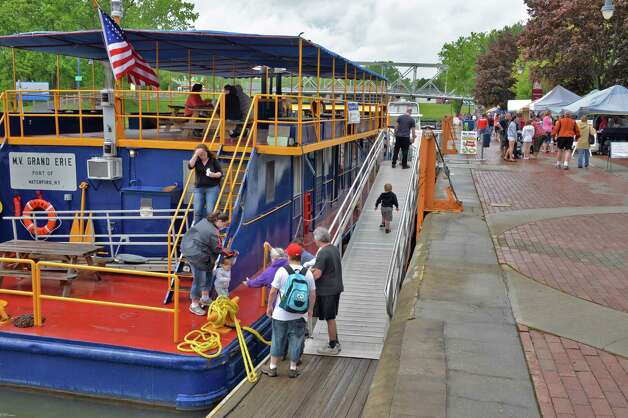 The NYS barge tug M.V. Grand Erie hosts tours at the 28th Annual Waterford/RiverSpark Canal Festival at the Waterford, NY Harbor Visitor Center Saturday May 11, 2013.  (John Carl D'Annibale / Times Union) Photo: John Carl D'Annibale / 00022346A
