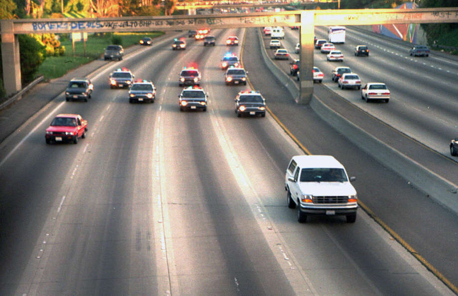 A white Ford Bronco driven by former football teammate Al Cowlings carrying O.J. Simpson is trailed by L.A. police after Simpson was charged with two counts of murder in 1994. Photo: Associated Press File Photos