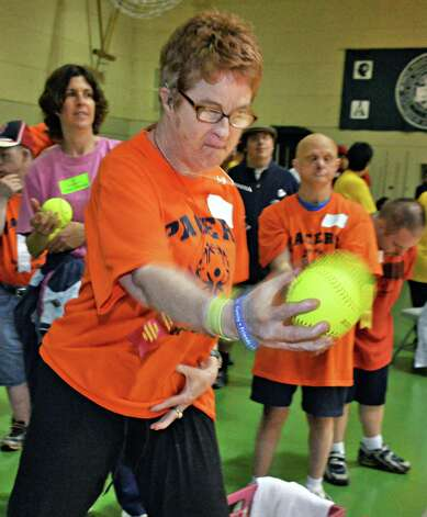 Katie Aman of Saratoga Springs throws a soft ball during the Special Olympics Spring Games South at HVCC's McDonough Sports Complex in Troy, NY Saturday May 11, 2013.  (John Carl D'Annibale / Times Union) Photo: John Carl D'Annibale / 00022371A