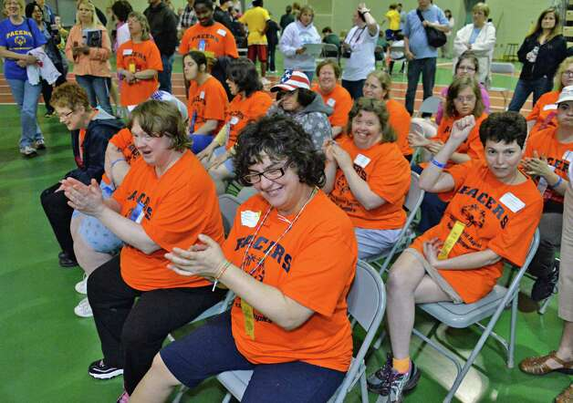 Competitors cheer each other on during the Special Olympics Spring Games South at HVCC's McDonough Sports Complex in Troy, NY Saturday May 11, 2013.  (John Carl D'Annibale / Times Union) Photo: John Carl D'Annibale / 00022371A