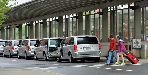Passengers walk past the taxi stand at the Albany Airport in Colonie, NY Saturday May 11, 2013. (John Carl D'Annibale / Times Union) Photo: John Carl D'Annibale / 00022378A