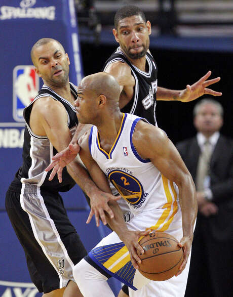 Jarrett Jack, hounded by the Spurs' Tony Parker and Tim Duncan in Game 3, will start Sunday if Stephen Curry can't. Photo: Edward A. Ornelas, San Antonio Express-News / © 2013 San Antonio Express-News
