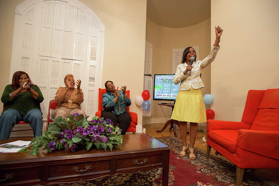 District 2 Councilwoman Ivy Taylor, right, gives a victory speech on election night at 328 N. Pine Street on Saturday, May 11, 2013. MICHAEL MILLER / FOR THE EXPRESS-NEWS Photo: Michael Miller, For The Express-News / San Antonio Express-News