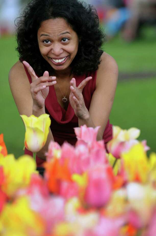 Anu Revur of Jersey City, N.J. poses for pictures during the Tulip Festival on Saturday, May 11, 2013, at Washington Park in Albany, N.Y. (Cindy Schultz / Times Union) Photo: Cindy Schultz / 00022344A