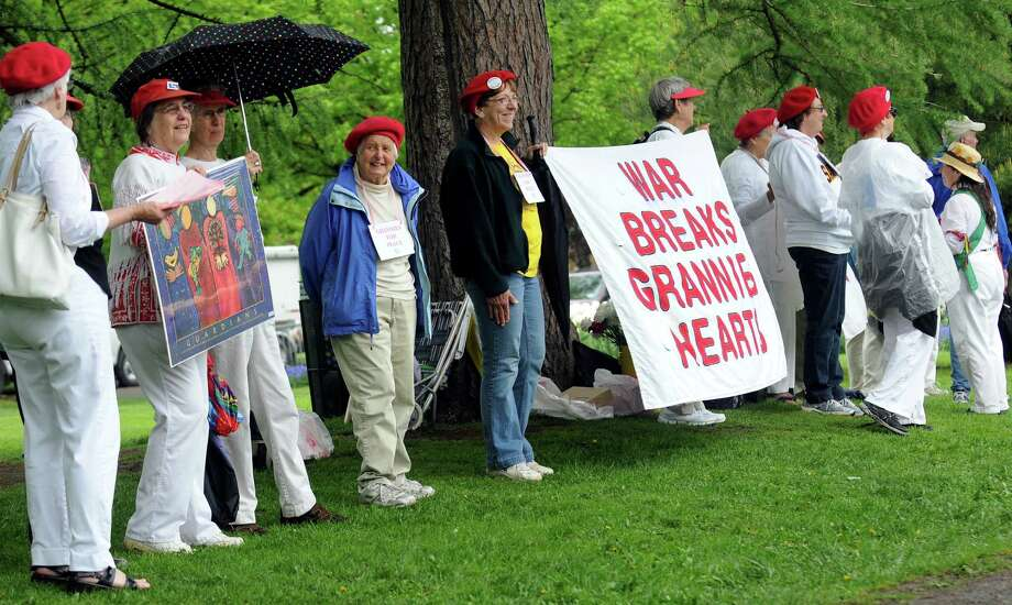 Grannies for Peace make their statement during the Tulip Festival on Saturday, May 11, 2013, at Washington Park in Albany, N.Y. (Cindy Schultz / Times Union) Photo: Cindy Schultz / 00022344A