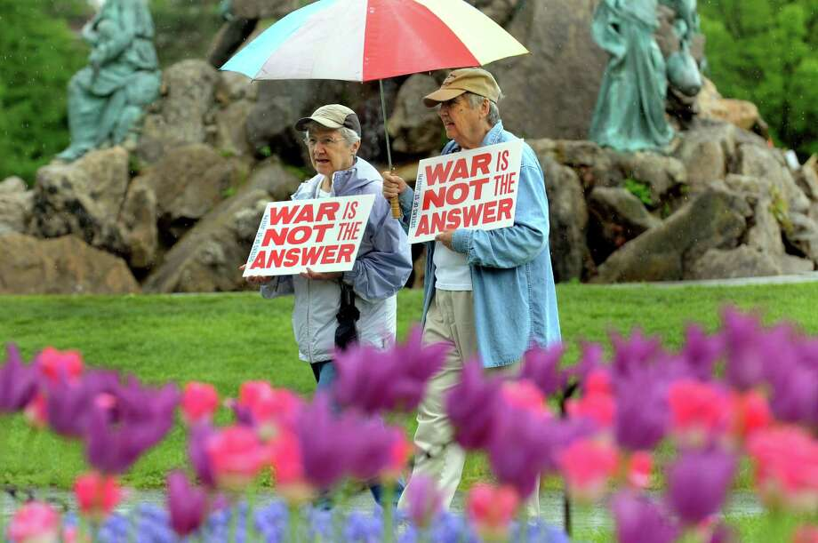 Sister Doreen Glynn, left, and Sister Francine Dempsey of the Sisters of Saint Joseph make their statement during the Tulip Festival on Saturday, May 11, 2013, at Washington Park in Albany, N.Y. (Cindy Schultz / Times Union) Photo: Cindy Schultz / 00022344A