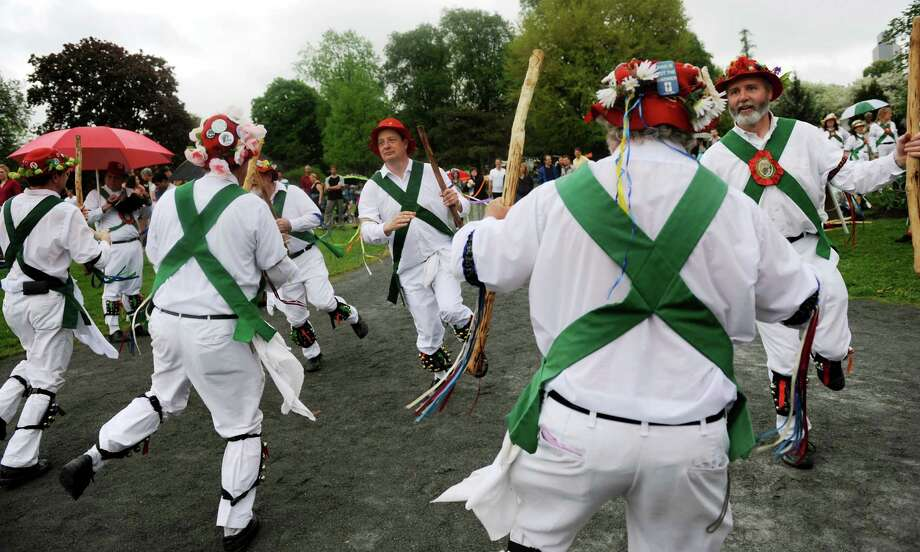 Members of the Pokingbrook Morris Dancers perform during the Tulip Festival on Saturday, May 11, 2013, at Washington Park in Albany, N.Y. (Cindy Schultz / Times Union) Photo: Cindy Schultz / 00022344A