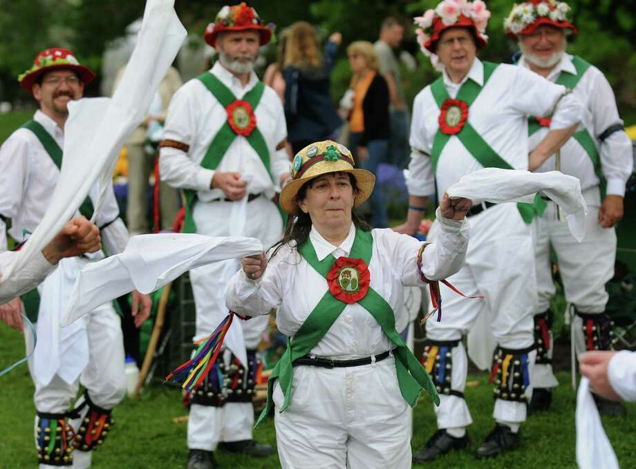 Joyce Cockerham of Troy performs with the Pokingbrook Morris Dancers during the Tulip Festival on Saturday, May 11, 2013, at Washington Park in Albany, N.Y. (Cindy Schultz / Times Union) Photo: Cindy Schultz / 00022344A