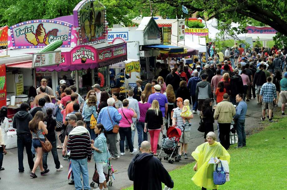 Festival goers cruise through the food alley during the Tulip Festival on Saturday, May 11, 2013, at Washington Park in Albany, N.Y. (Cindy Schultz / Times Union) Photo: Cindy Schultz / 00022344A