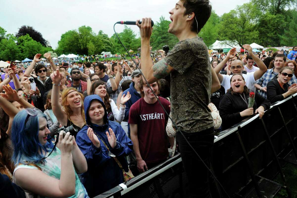 Gary Larsen of Royal Teeth gets close to the audience during their performance on the main stage during the Tulip Festival on Saturday, May 11, 2013, at Washington Park in Albany, N.Y. (Cindy Schultz / Times Union)