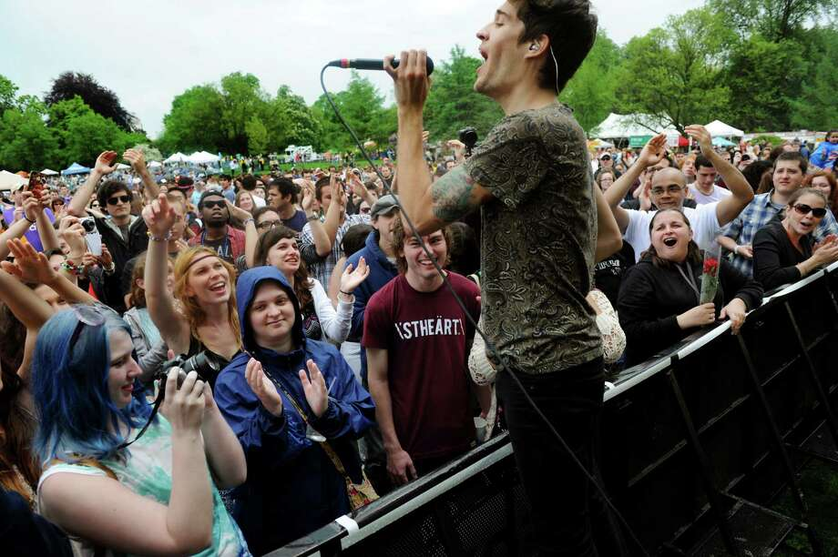 Gary Larsen of Royal Teeth gets close to the audience during their performance on the main stage during the Tulip Festival on Saturday, May 11, 2013, at Washington Park in Albany, N.Y. (Cindy Schultz / Times Union) Photo: Cindy Schultz / 00022344A