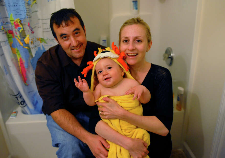 The Bloom family: Zack, wife Marisa Torrieri and Nathan, 9 months, pose at their home on Andrassy Avenue in Fairfield, Conn. on Wednesday May 8, 2013. The Bloom family is part of a trend where couples are waiting until later in life to have children. Photo: Christian Abraham / Connecticut Post