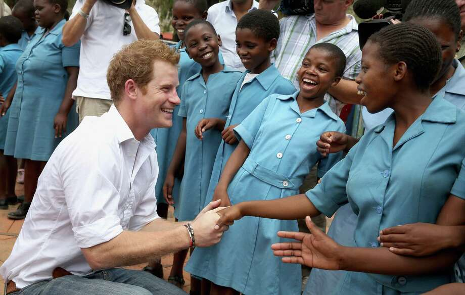 Prince Harry meets 15-year-old orphan Keneuoe at St Bernadette's Centre for the Blind, a project supported by his charity Sentebale on Feb. 27, 2013 in Maseru, Lesotho. Sentebale is a charity founded by Prince Harry and Prince Seeiso of Lesotho. Prince Harry is due to play a polo match at the Greenwich Polo Club in Greenwich, Conn., Wednesday, May 15, 2013 in support of the charity.  (Photo by Chris Jackson/Getty Images) Photo: Chris Jackson, Getty Images / 2013 Getty Images