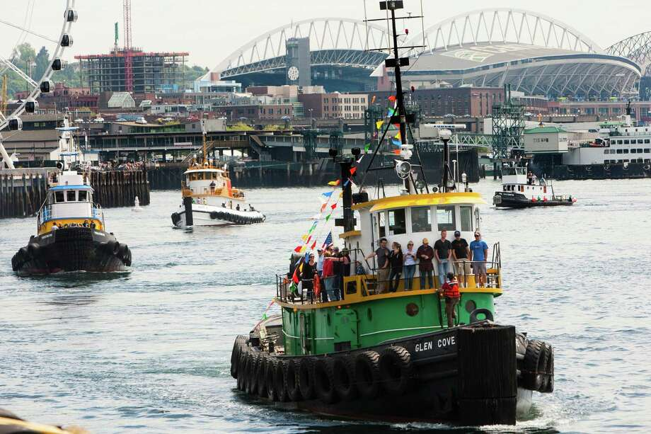 Colorful boats trundle through Puget Sound during the boat parade on the final day of the annual Seattle Maritime Festival Saturday, March 11, 2013, on Pier 66 in Seattle. The four-day festival included a clam chowder cook off, tugboat races and boatbuilding competitions. Photo: JORDAN STEAD, SEATTLEPI.COM / SEATTLEPI.COM