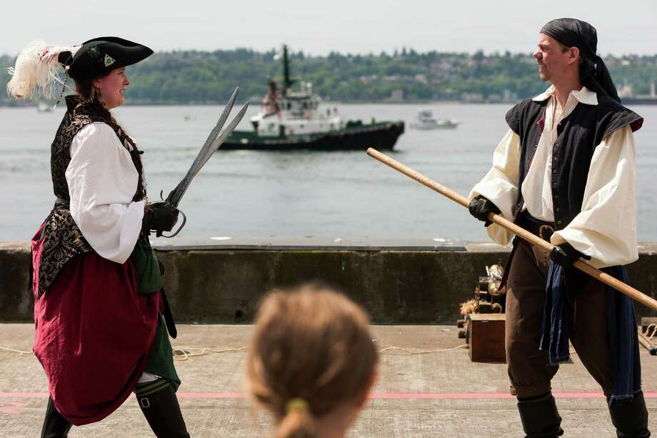 Members of the B.O.O.M. Pirates entertain young onlookers with a sword fight on the final day of the annual Seattle Maritime Festival Saturday, March 11, 2013, on Pier 66 in Seattle. The four-day festival included a clam chowder cook off, tugboat races and boatbuilding competitions. Photo: JORDAN STEAD, SEATTLEPI.COM / SEATTLEPI.COM