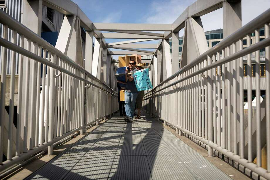 WorkBoat World Invitational Boatbuilding Competition attendees move their completed boats to the water on the final day of the annual Seattle Maritime Festival Saturday, March 11, 2013, on Pier 66 in Seattle. The four-day festival included a clam chowder cook off, tugboat races and boatbuilding competitions. Photo: JORDAN STEAD, SEATTLEPI.COM / SEATTLEPI.COM
