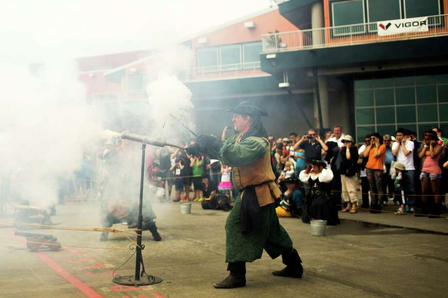A member of the B.O.O.M. Pirates shoots a live cannon during a firepower showcase on the final day of the annual Seattle Maritime Festival Saturday, March 11, 2013, on Pier 66 in Seattle. The four-day festival included a clam chowder cook off, tugboat races and boatbuilding competitions. Photo: JORDAN STEAD, SEATTLEPI.COM / SEATTLEPI.COM