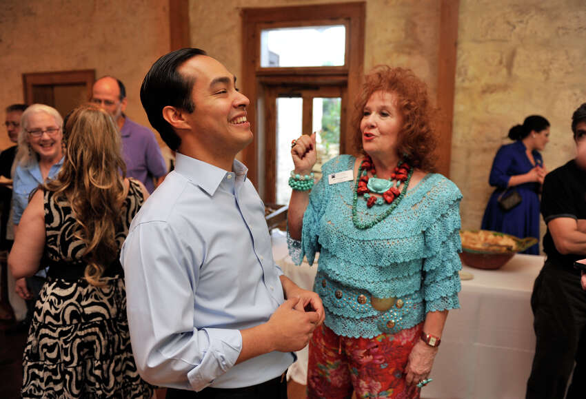 Mayor Julian Castro laughs while talking with Dr. Yvonne Katz during an election night rally Saturday.