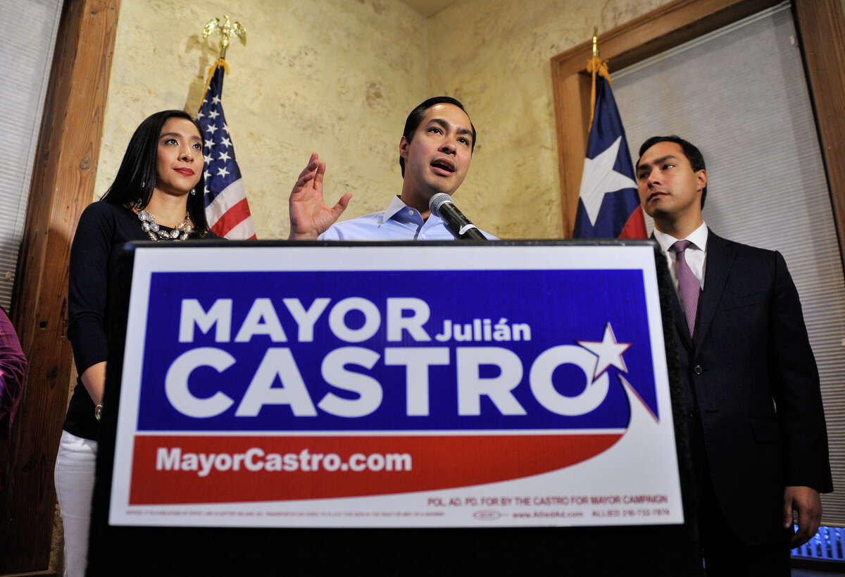 Mayor Julian Castro speaks to supporters Saturday evening flanked by his wife Erica, and brother, Congressman Joaquin Castro.