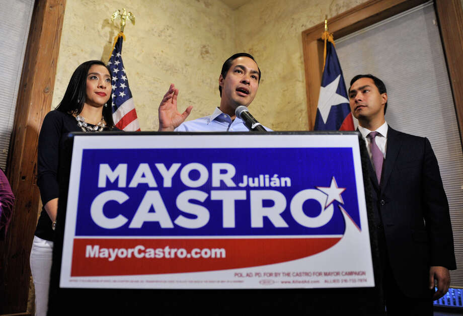 Mayor Julian Castro speaks to supporters Saturday evening flanked by his wife Erica, and brother, Congressman Joaquin Castro. Photo: Robin Jerstad, For The Express-News / San Antonio Express-News