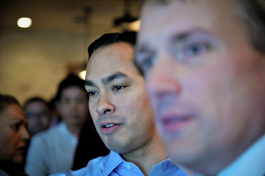 Mayor Julian Castro watches election night voting returns with campaign manager Christian Archer Saturday evening. Photo: Robin Jerstad