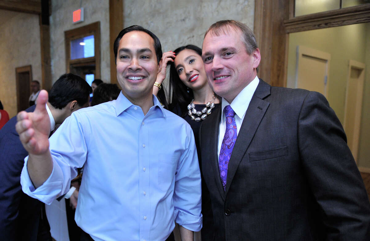Mayor Julian Castro watches election returns Saturday evening with his wife Erica and campaign manager Christian Archer.