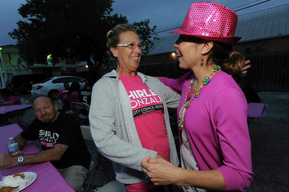 Tinker Mass, left, greets City Council District 5 candidate Shirley Gonzales on election night, Saturday, May 11, 2013. Photo: Billy Calzada, San Antonio Express-News / San Antonio Express-News