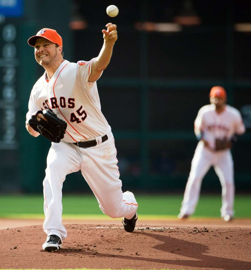 Astros pitcher Erik Bedard delivers a pitch against the Rangers.