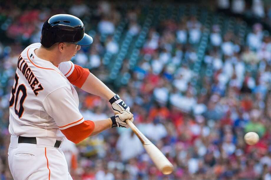 Astros third baseman Matt Dominguez hits a home run during the third inning. Photo: Smiley N. Pool, Houston Chronicle