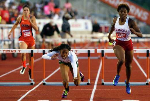 Edinb's Leigha Brown, left, trails Spring's Alaysh'A Johnson, as she falls to the ground while Atascocita's Ariel Jones, right, continues in the 5A Girls 300 Meter Hurdles during the UIL High School State Track Meet at Mike A. Myers Stadium Saturday, May 11, 2013, in Austin. Photo: Cody Duty, Houston Chronicle / © 2013 Houston Chronicle