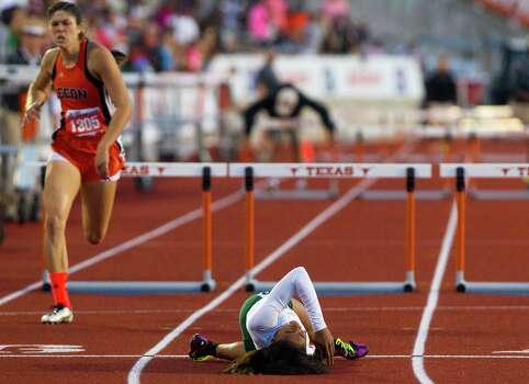 Edinb's Leigha Brown, left, sprints past Spring's Alaysh'A Johnson, right, as they compete in the 5A Girls 300 Meter Hurdles during the UIL High School State Track Meet at Mike A. Myers Stadium Saturday, May 11, 2013, in Austin. Photo: Cody Duty, Houston Chronicle / © 2013 Houston Chronicle
