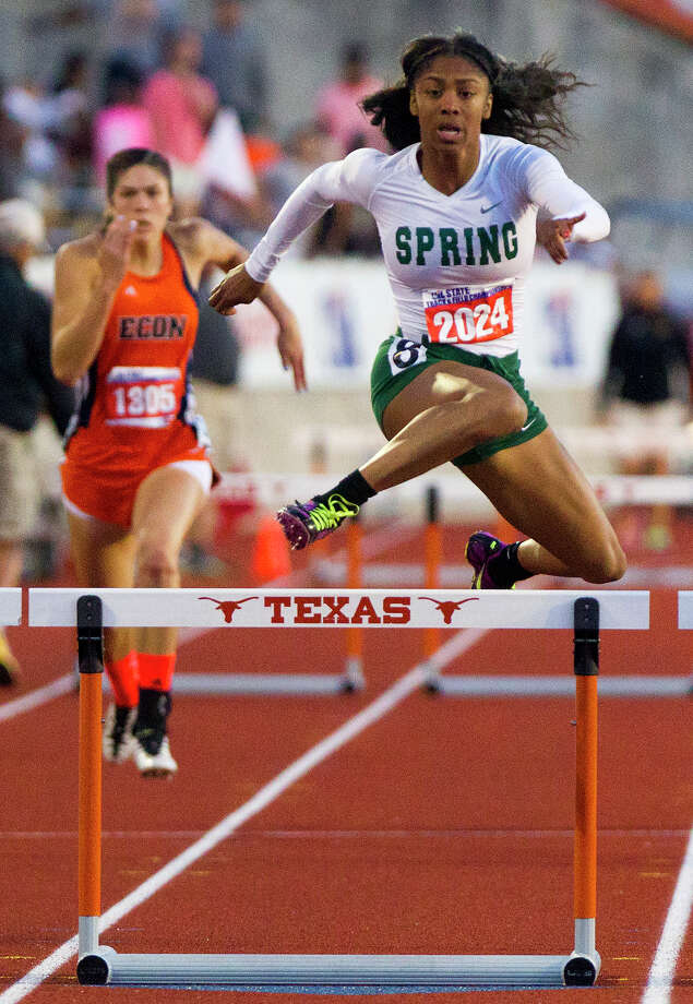 Edinb's Leigha Brown, left, trails Spring's Alaysh'A Johnson, right, as they compete in the 5A Girls 300 Meter Hurdles during the UIL High School State Track Meet at Mike A. Myers Stadium Saturday, May 11, 2013, in Austin. Photo: Cody Duty, Houston Chronicle / © 2013 Houston Chronicle