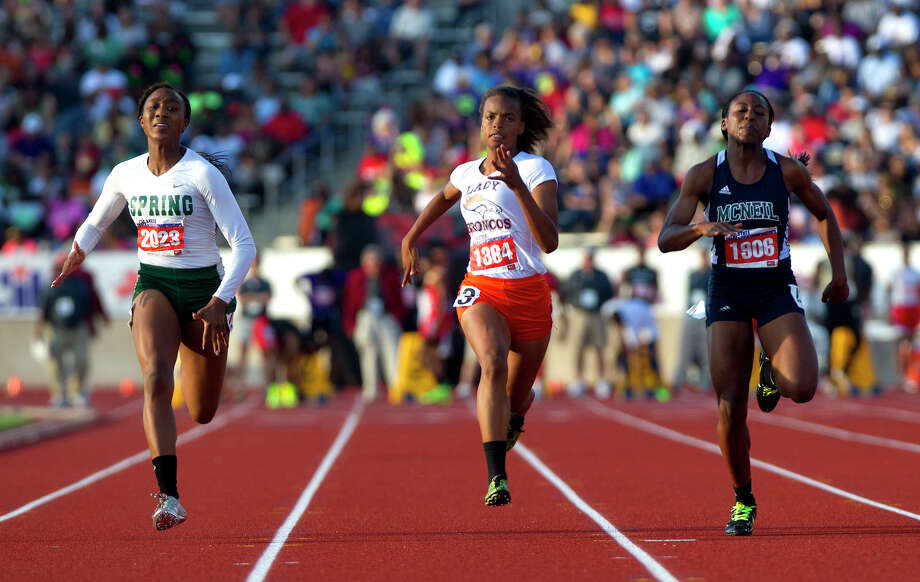 Spring's Taylor Bennett, left, and Fort Bend Bush's Rushell Harvey, center, compete in the 5a Girls 100 Meter Dash during the UIL High School State Track Meet at Mike A. Myers Stadium Saturday, May 11, 2013, in Austin. Photo: Cody Duty, Houston Chronicle / © 2013 Houston Chronicle