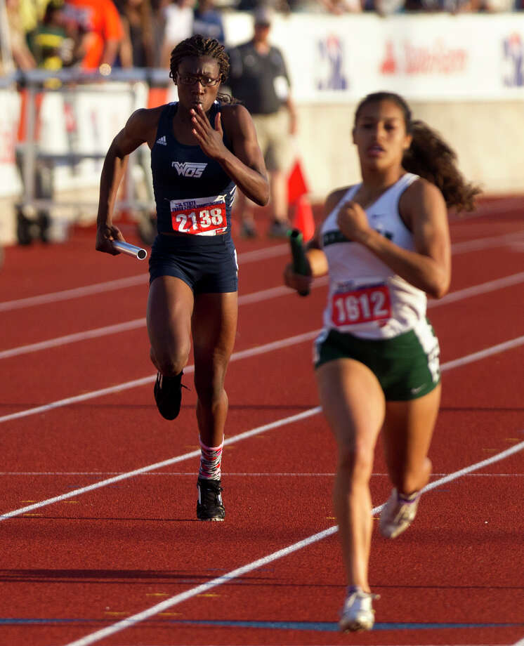 West Orange Stark's Aaliyah Teel, left, runs the last leg of the 3A Girls 4x200 Meter Relay during the UIL High School State Track Meet at Mike A. Myers Stadium Saturday, May 11, 2013, in Austin. Photo: Cody Duty, Houston Chronicle / © 2013 Houston Chronicle